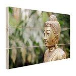 Oud Bouddha standbeeld in een tuin - Hout