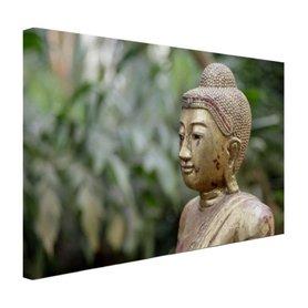 Oud Bouddha standbeeld in een tuin - Canvas