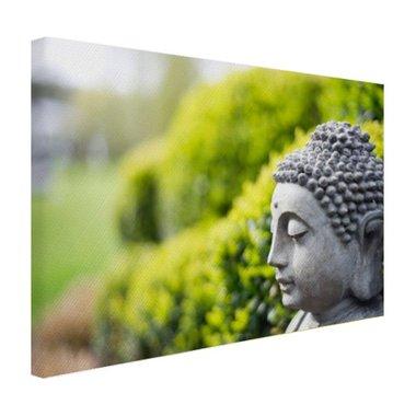 Standbeeld van Boeddha in een tuin - Canvas