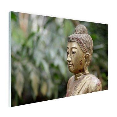 Oud Bouddha standbeeld in een tuin - Plexiglas