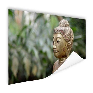 Oud Bouddha standbeeld in een tuin - Poster